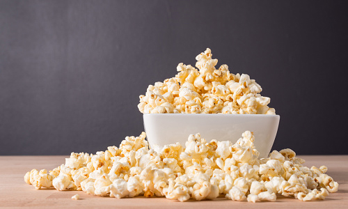 Bowl of popcorn on a wooden table